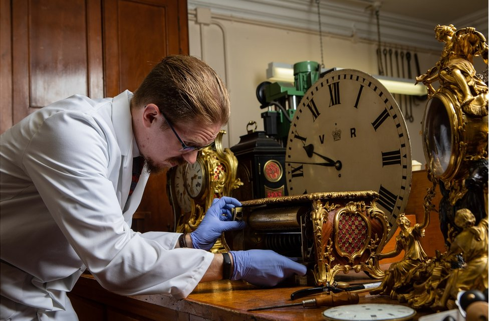 Fjodor works on a clock case in his workshop