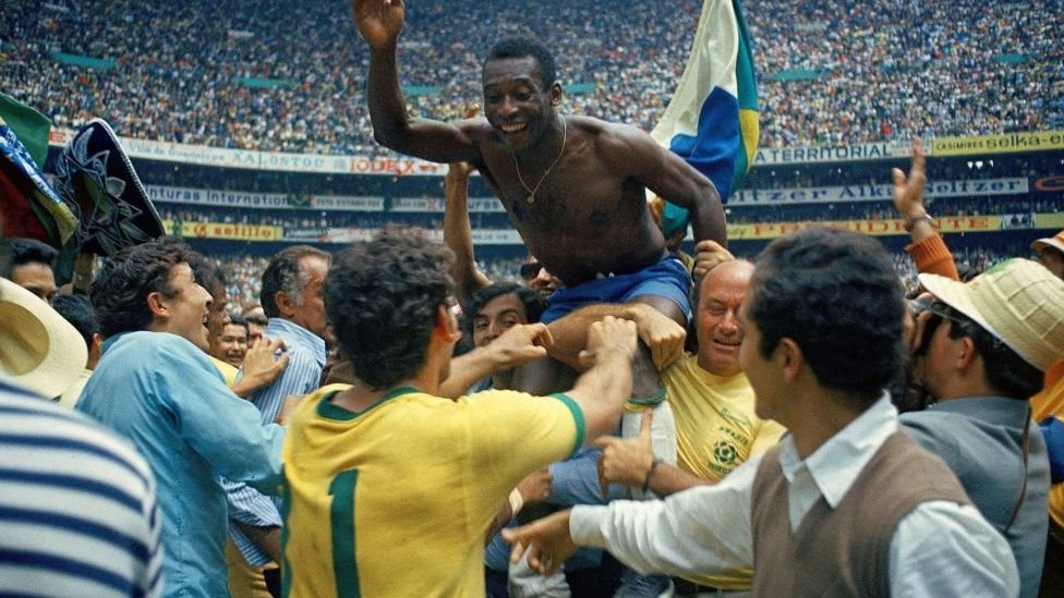 Pele on supporters' shoulder after Brazil's 4-1 victory over Italy in the final of the 1970 Fifa World Cup