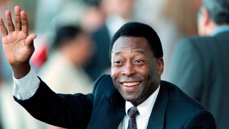 Pele salutes a crowd during a public engagement in 1995 as Brazil's Sport minister