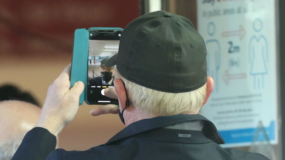 Mr Becker appears to record himself on his mobile phone at Southwark Crown Court