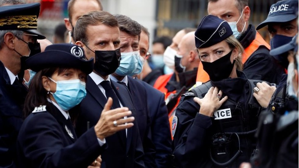 French President Emmanuel Macron (3rd left) meeting police officers in Nice. Photo: 29 October 2020