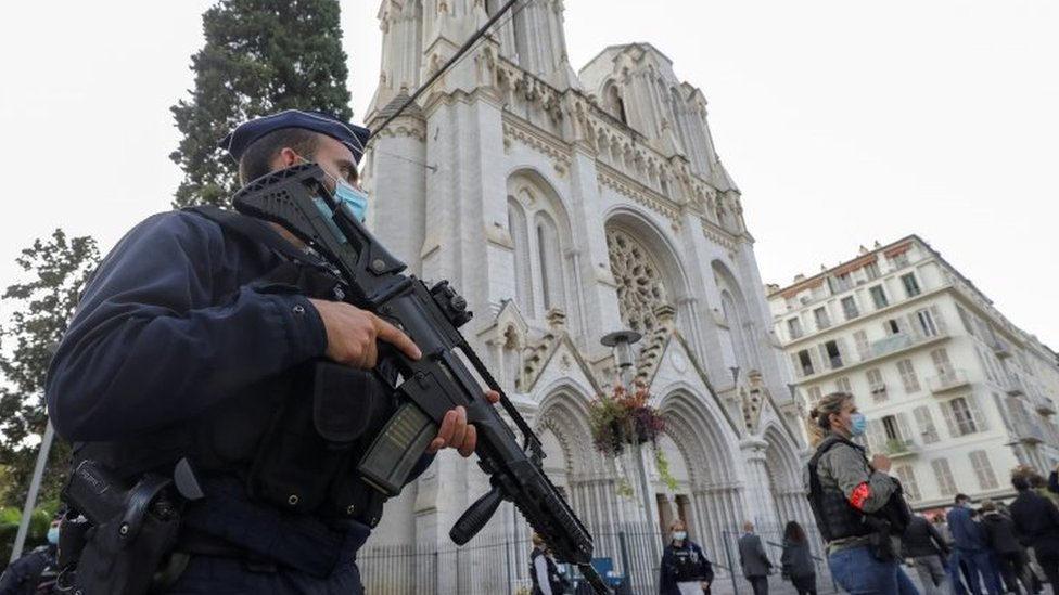 Police officers stand outside the Notre Dame church in Nice