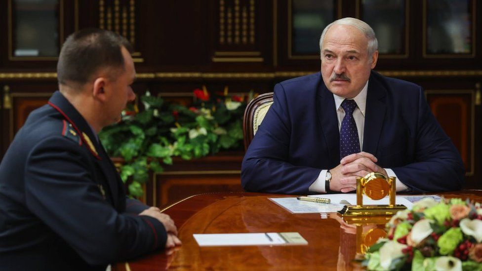President Alexander Lukashenko pictured with his minister of Internal Affairs, Ivan Kubrakov (L)