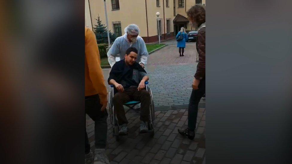 Khoroshyn leaves a hospital in Lithuania on a wheelchair