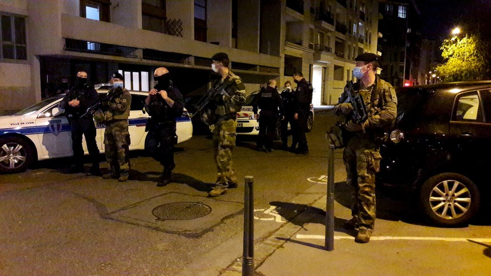 Police secure a street after a Greek Orthodox priest was shot and injured at a church in the centre of Lyon, France October 31, 2020.