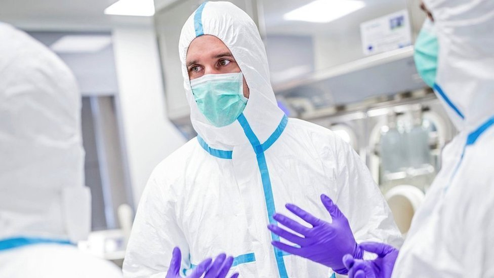 Medical staff in protective suit