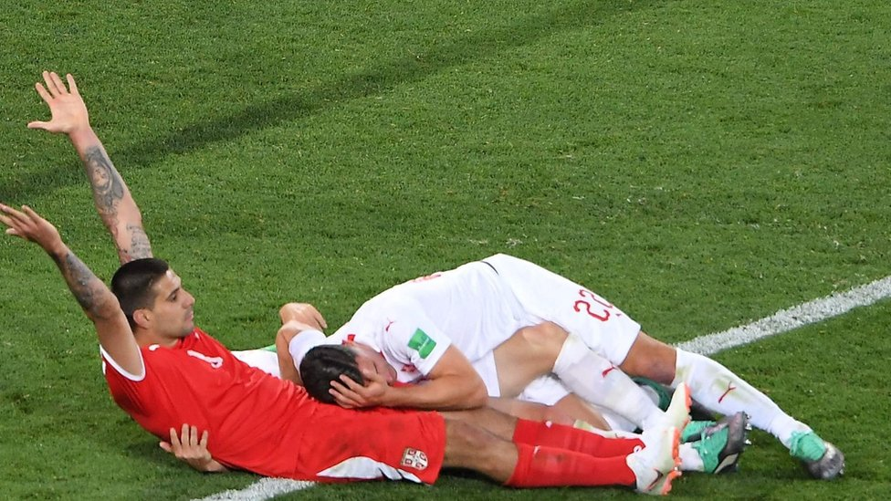 Serbia's Aleksandar Mitrovic reacts after a tackle against Switzerland