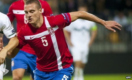 Manchester United defender Nemanja Vidic and scored twice for his country