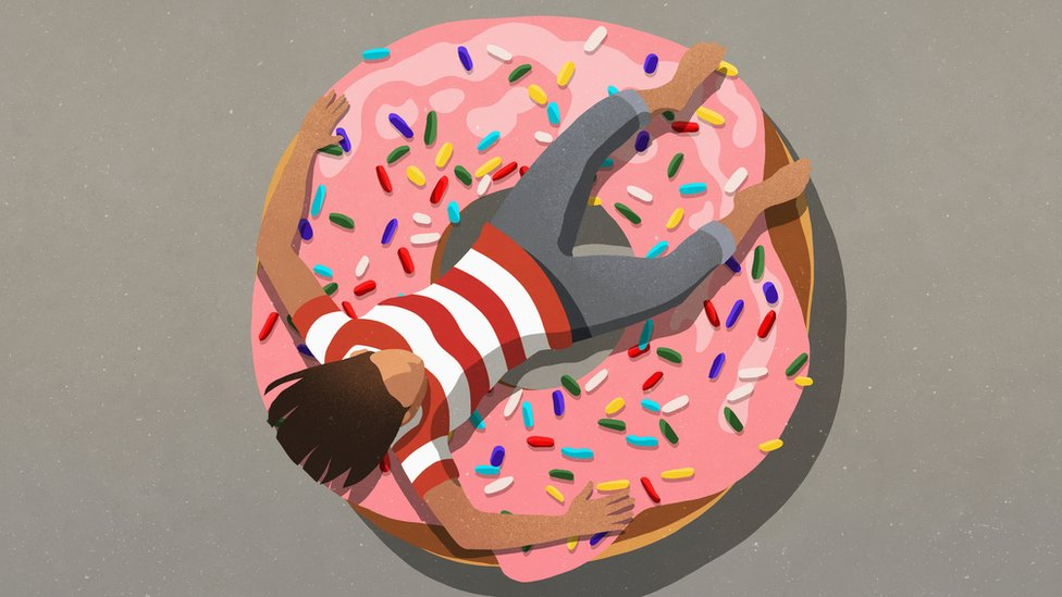 Person resting over a giant donut