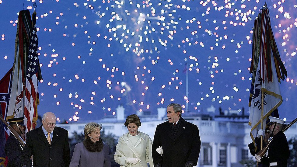 George W Bush, his wife Laura Bush, Dick Cheney and Lynne Cheney watch fireworks as part of inaugural celebrations