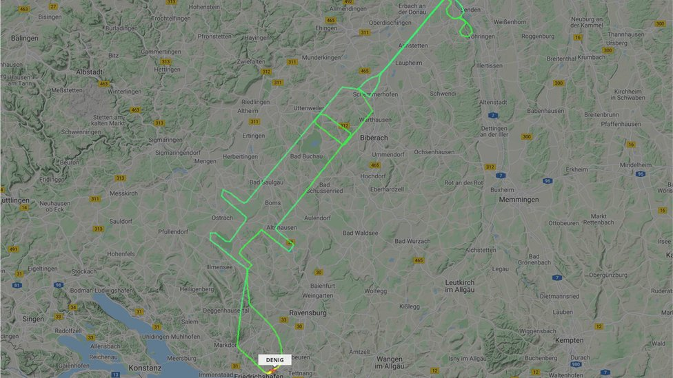 A flightradar24.com handout photo received on December 27, 2020 shows the flight track for a D-ENIG plane that traced a syringe on the maps in Germany to celebrate the arrival of a COVID-19 vaccine.