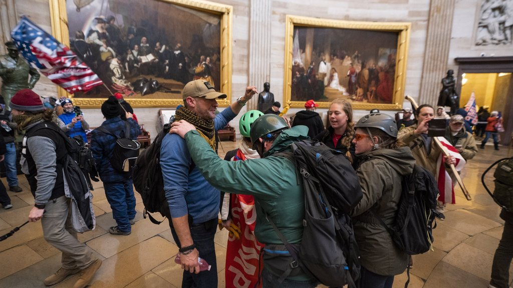 Supporters of US President Donald J. Trump in the Capitol rotunda after breaching security