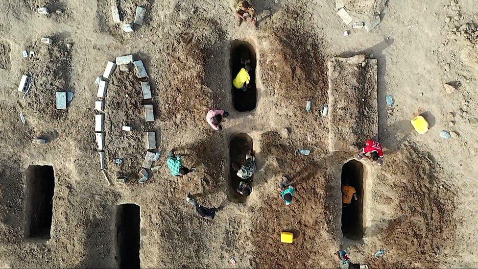 Digging graves in al-Radwan cemetery