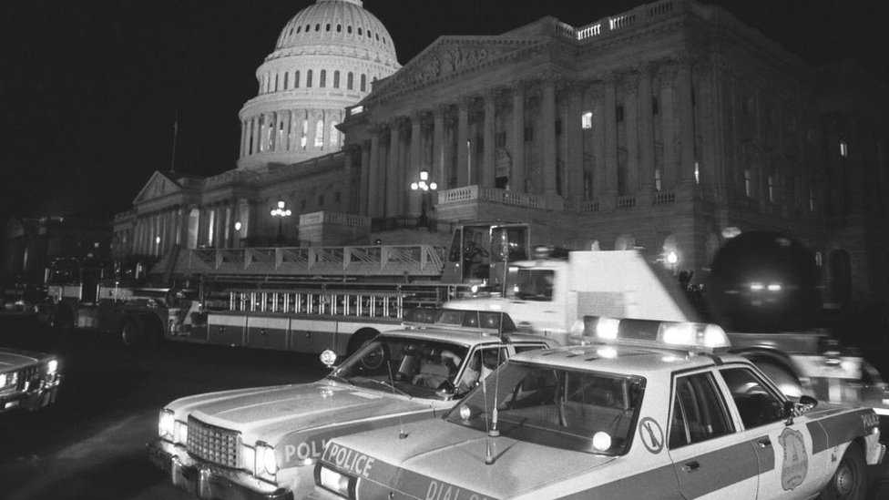 Police cars outside the Capitol after the 1983 attack