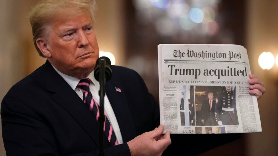 U.S. President Donald Trump holds a copy of The Washington Post with the headline 'Trump acquitted'Senate acquitted on February 6, 2020.