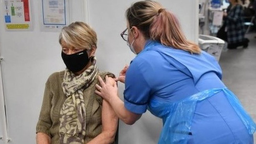Rita Passey receives an injection of a Covid-19 vaccine in Birmingham