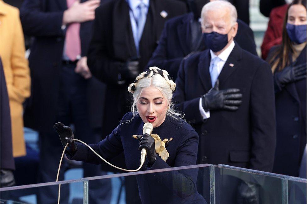 Lady Gaga sings with Joe Biden standing behind her