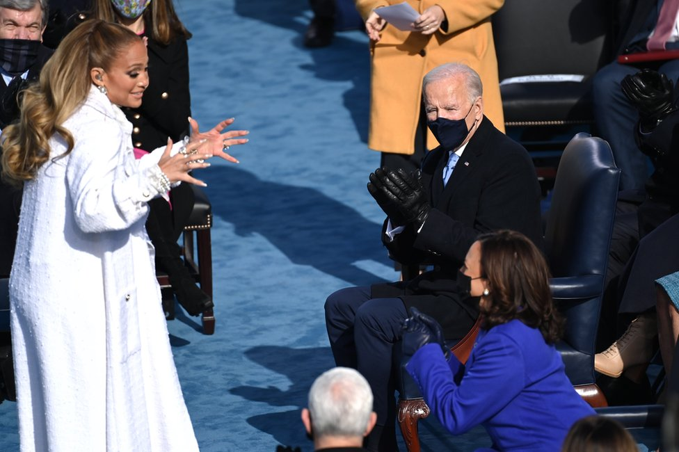 Jennifer Lopez gestures to Kamala Harris
