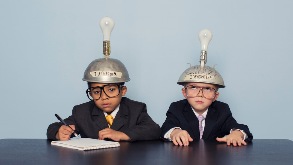 """Two children wearing """"thinking hats"""""""