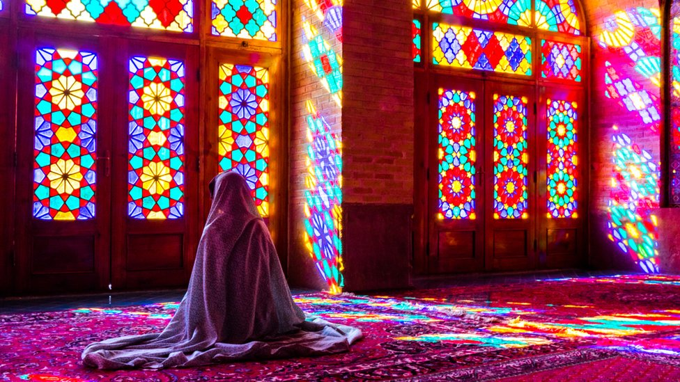 Woman praying in a Mosque