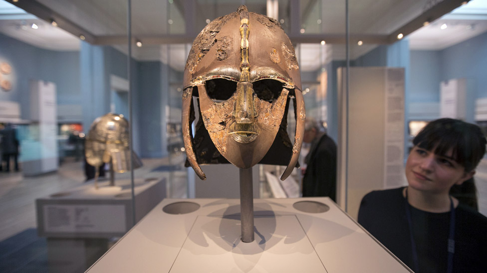 A woman views the Sutton Hoo Helmet on display in the new gallery 'Sutton Hoo and Europe AD 300-1100' in the British Museum