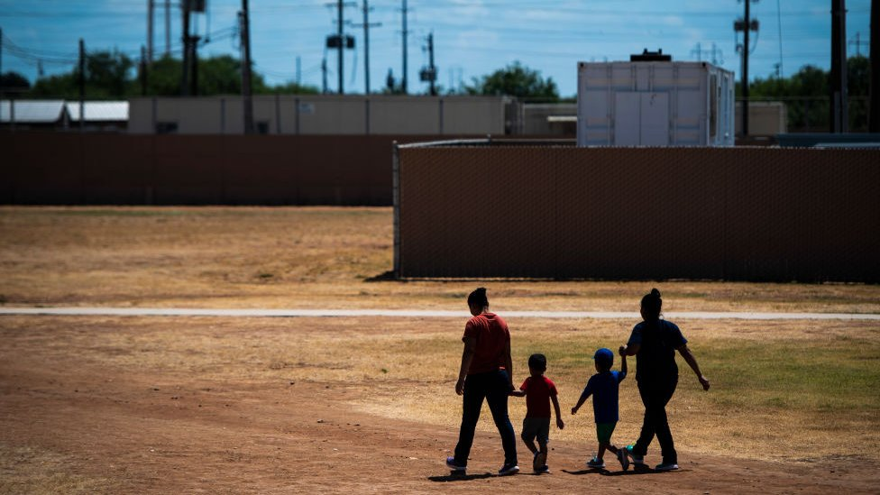 Two mothers walk with their children at the South Texas Family Residential Center in 2019.