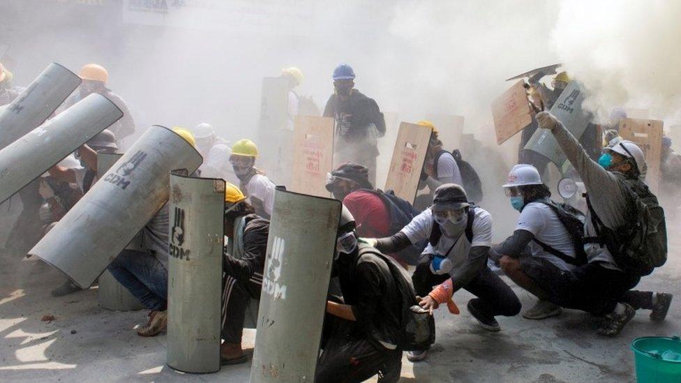 Protesters take cover in Yangon