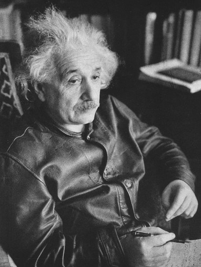 Portrait of Einstein, wearing a leather jacket and with his characteristic messy hair.