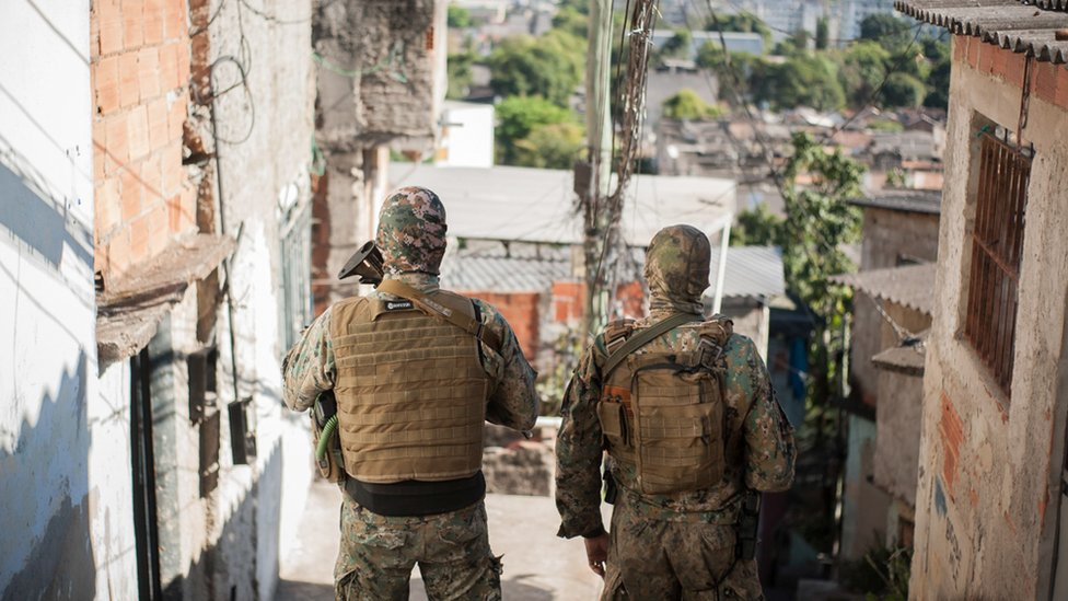 Two armed police officers in a favela