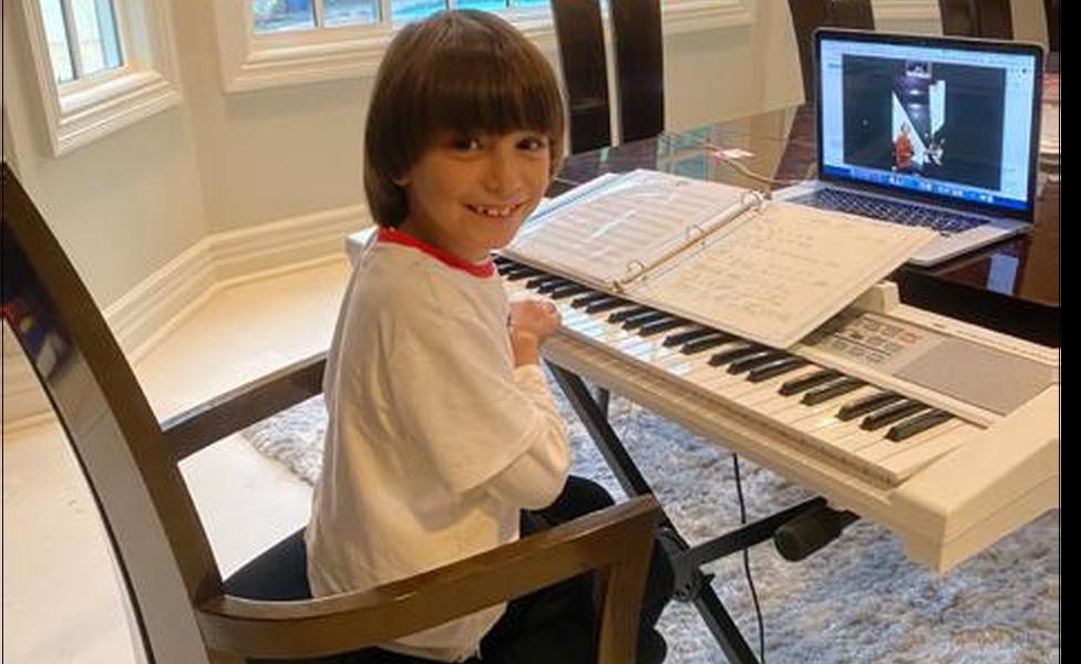 Joseph at his piano