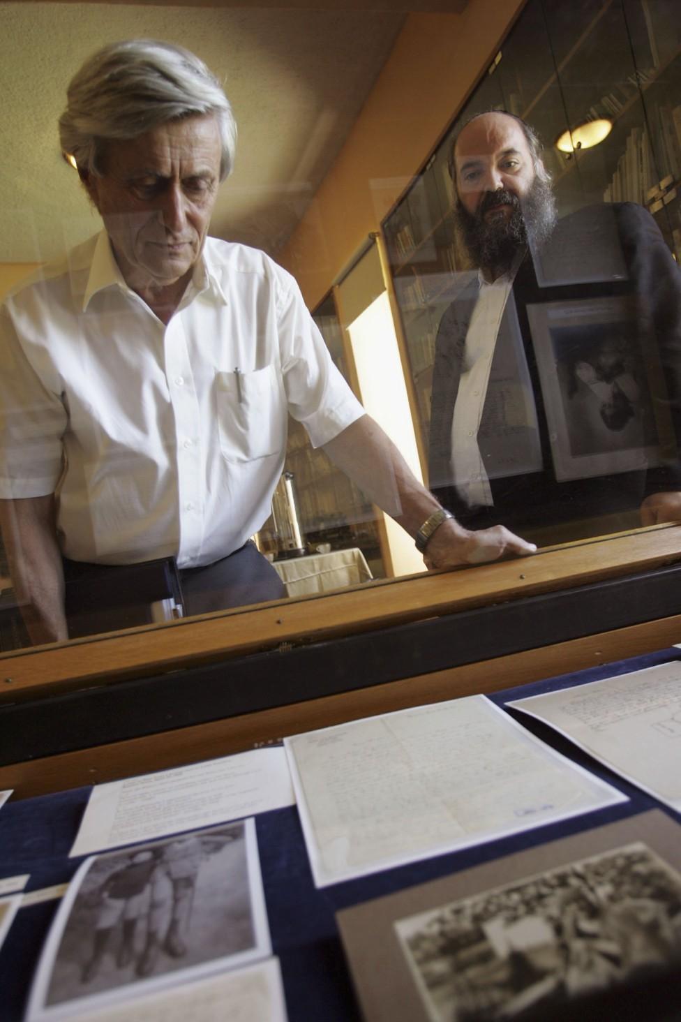 Professor Gutfreund (left) with Albert Einstein's papers held at the Hebrew University in Jerusalem, Israel
