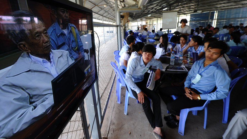 Cambodians watch the trial of former Khmer Rouge jailer Kaing Guek Eav (Duch)