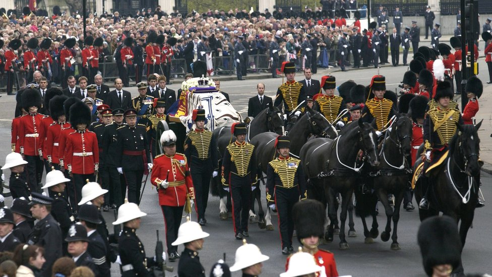 Prince Charles, Prince Philip, Prince Harry and Prince William walk behind the coffin of the Queen Mother in 2002 as it arrives at Westminster Abbey