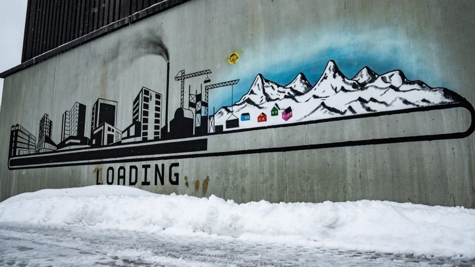 A mural in Nuuk shows the development of Greenland's natural resources