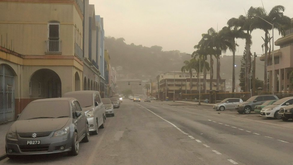 Ash covers roads a day after the La Soufriere volcano erupted after decades of inactivity, in Kingstown, St Vincent and the Grenadines April 10, 2021