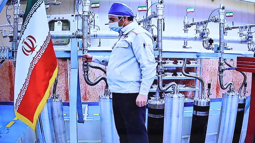 A handout picture made available by the Iranian presidency shows a technician working inside the Natanz uranium enrichment plant during a video conference with President Hassan Rouhani on the occasion of Iran Nuclear Technology Day (10 April 2021)