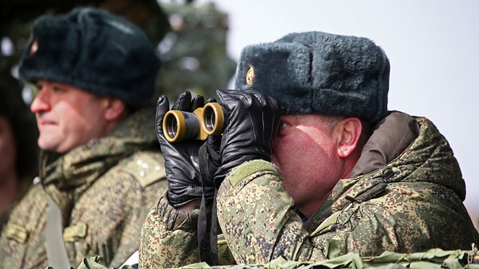 A Russian commander looks on during military exercises in Crimea, 19 March 2021