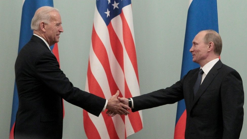 Russian Prime Minister Putin shakes hands with US Vice-President Biden during their meeting in Moscow, March 2011