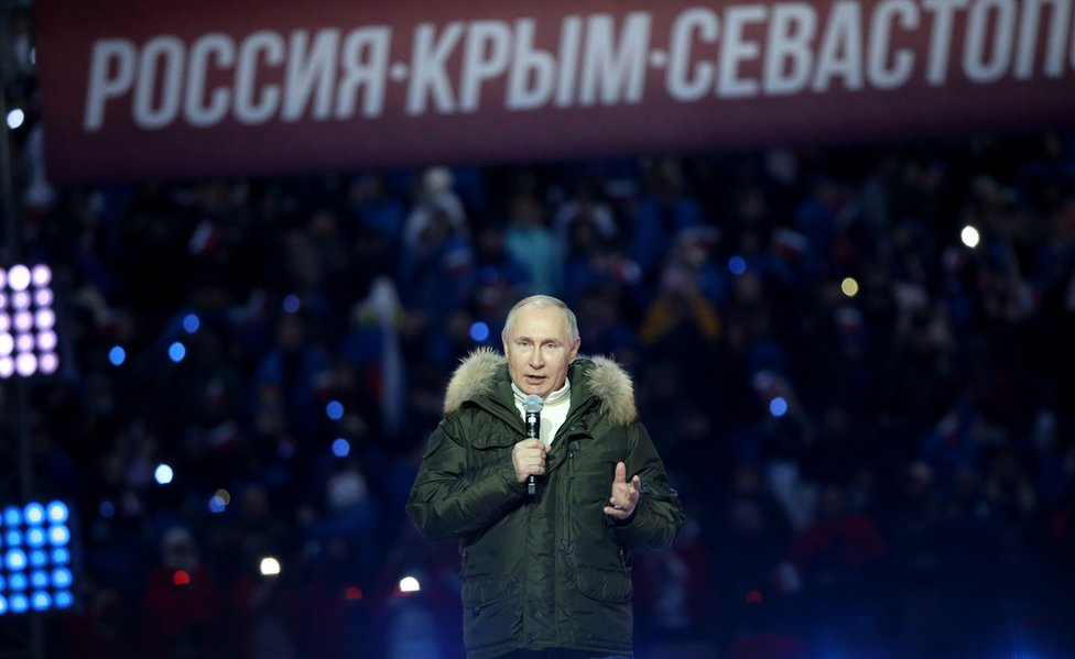 Russian President Vladimir Putin speaks during a concert marking the 7th anniversary of Crimea annexation, on March 18, 2021 in Moscow, Russia