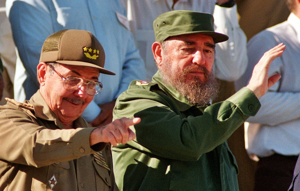 Fidel Castro and his brother Raul attend a May Day parade December 2, 1996 in Havana, Cuba. (Photo by Sven Creutzmann/Mambo Photography/Getty Images)