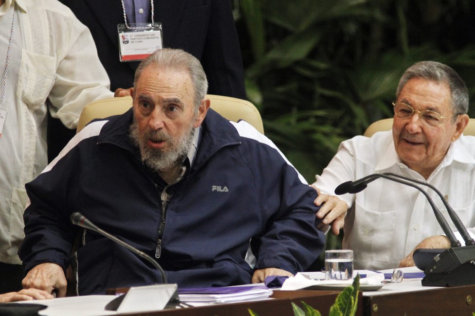 Raul Castro, President of Cuba (R) tries to hold back his brother and Revolution leader Fidel Castro (L) from getting up, during the closing session of the 6th Party Congress after Raul Castro had been officially elected as Fidel Castro's successor as head of Cuba's ruling communist Party PCC in the Palacio de las Convenciones on April 19, 2011 in Havana, Cuba.(Photo by Sven Creutzmann/Mambo Photo/Getty Images)