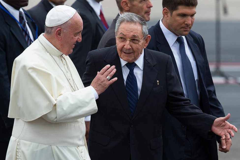 Pope Francis walks with Cuba's President Raul Castro (R) as he arrives at Jose Marti International Airport on September 19, 2015 in Havana, Cuba.