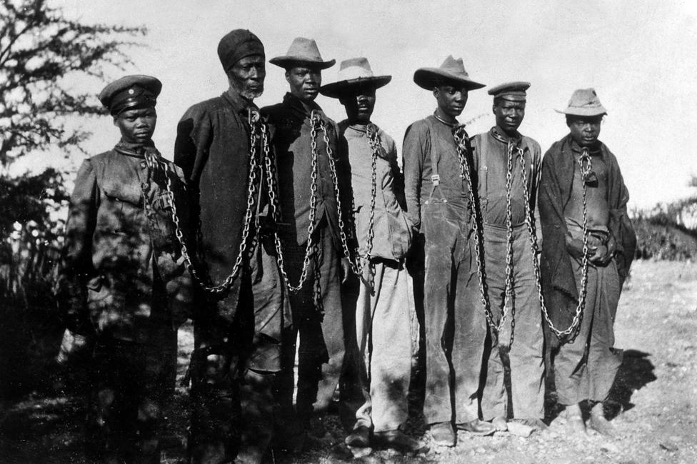 Herero prisoners in chains (1904)