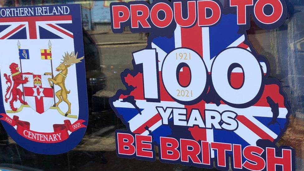 Proud to be British poster displayed in shop window