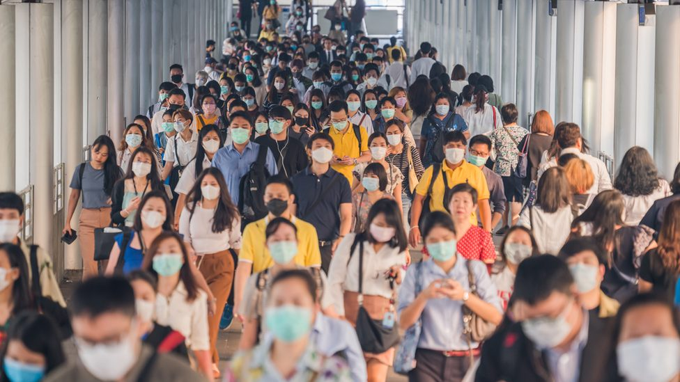 A large group of people wearing masks
