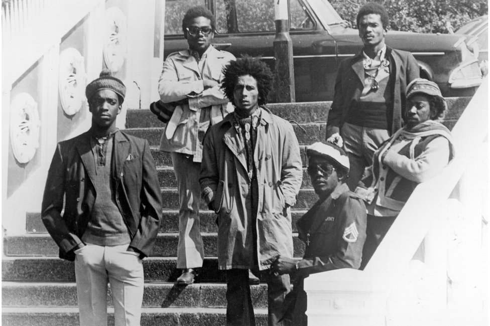 Bob Marley and The Wailers pose on steps in London