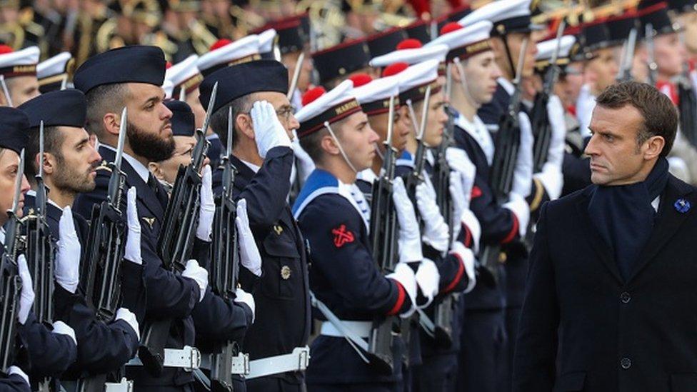 French President Emmanuel Macron reviews troops