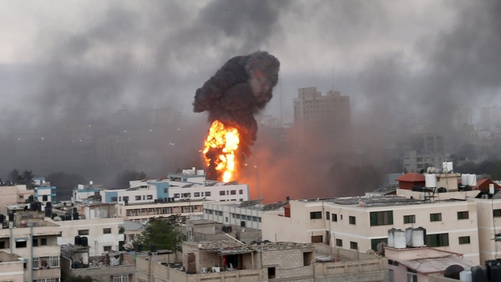 Smoke and flames rise during Israeli air strikes amid a flare-up of Israeli-Palestinian violence in Gaza
