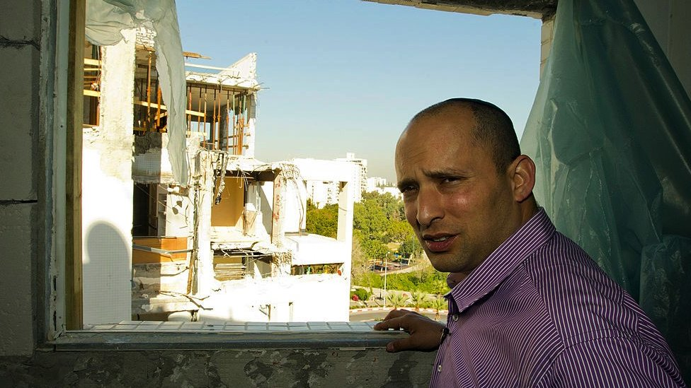 Naftali Bennett, then head of the Israeli hardline national religious party, Jewish Home, visits a destroyed apartment in 2012.