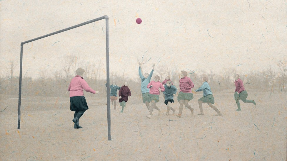 A group of girls playing football